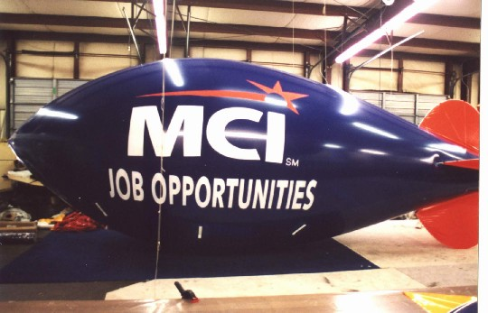 Coolest Blimps - 30 ft advertising blimp with MCI logo