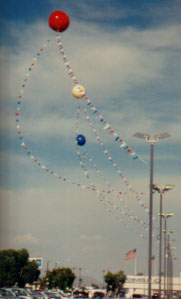 giant balloons shown in air attached with pennants