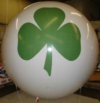 big balloon with green shamrock logo