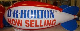 Advertising blimp with D.R. Horton logo