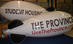 Advertising blimps for apartment promotions. Apartment marketing using advertising blimps. 20 ft. blimp. class=
