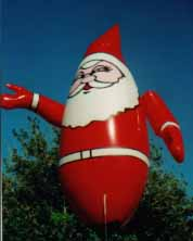 Christmas Helium Balloons - 11 ft. Santa helium balloon - great for small events and parades. Christmas helium balloon made in the USA.