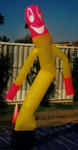 Big Balloons - Yellow pink dancing  guy balloon. Big balloons available for sale and rent!