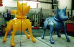 Product Replica of two mechanical dogs - all types of custom balloons available.