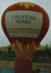 Giant Balloons - hot-air balloon shape cold-air advertising balloons. Great traffic builders for your sale or event.