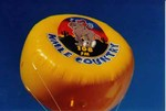 8' helium disk - advertising balloon with complex artwork - KMLE
