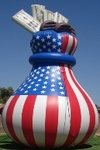 Inflatable Advertising Balloons - Money bag - 25ft. tall red, white and blue moneybag advertising balloon. Our cold-air money bag inflatables create traffic!