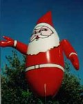 Santa - 11' helium inflatable. Affordable inflatable that really attracts attention.