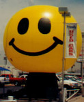Smiley Face Balloon - giant 25ft. tall Happy Face cold-air inflatables for purchase and rent.