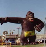 Advertising balloons - cold-air Kong inflatables in stock - custom banners and artwork available. Kongs and gorilla balloons are our most popular shapes! 40ft. brown Kong - HUGE!